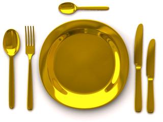 Golden empty plate with fork, spoon and knife on white
