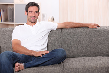 portrait of a man on a couch