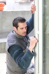 Man fitting new window