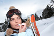 Skier applying lip salve