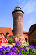 Medieval tower of Nuremberg Castle with flowers