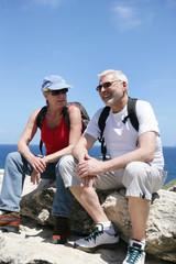 Couple taking a break on a hike