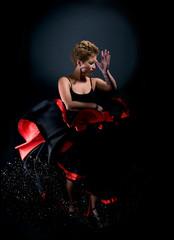 Portrait of beautiful young woman dancing flamenco studio shot