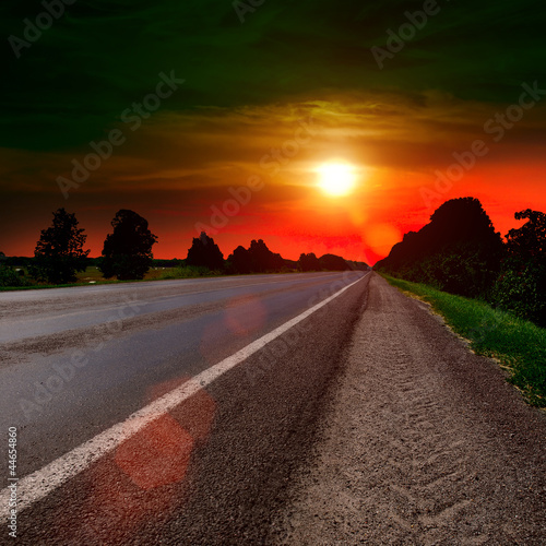 asphalt road at sunset