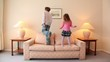 Two kids jump on sofa at room with lamps on each side