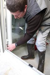 Worker installing a new door