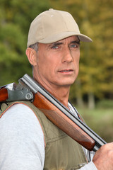 Hunter with rifle on shoulder