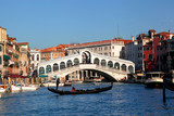 Fototapeta Rialto Bridge with gondola in Venice, Italy