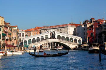 Rialto Bridge with gondola in Venice, Italy