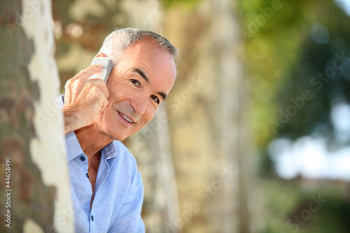 Senior man with telephone