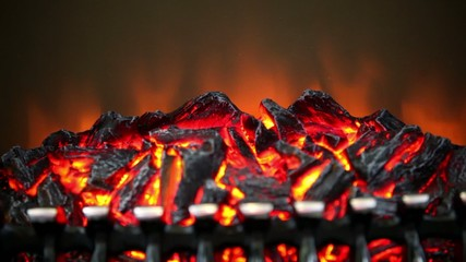 Artificial smoldering embers with small amount of fire