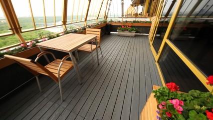 Little table for two stand on restaurant terrace on upper floor