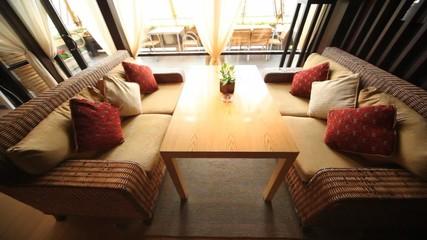 Wicker sofas stand in restaurant lounge