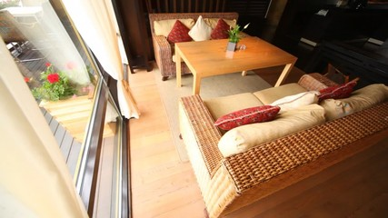 Wicker sofa stand in restaurant lounge fenced  from of terrace