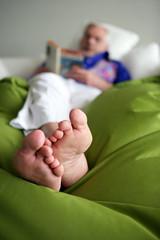 senior reading in bed