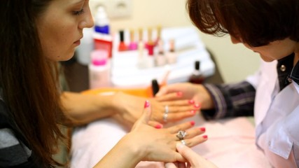 Cosmetician has made to client of manicure