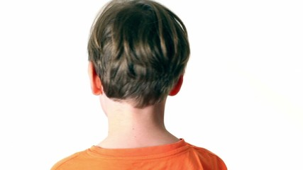 Little boy looks and turn around isolated