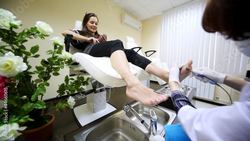 Flying motion of camera in room for pedicure to face of woman
