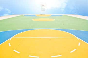 Basket ball field with sun