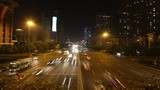 Cars go on night highway to Guangzhou Bridge