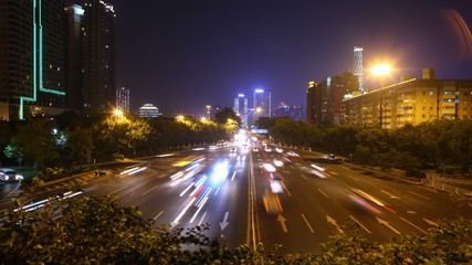 Cars go on night high-speed road