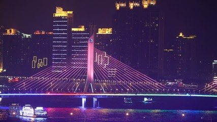 Jiangwan bridge stands and shine of light near to floating boats