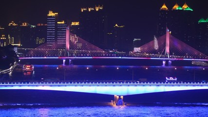 Tourist ship is turn near to Haiyin Bridge in night