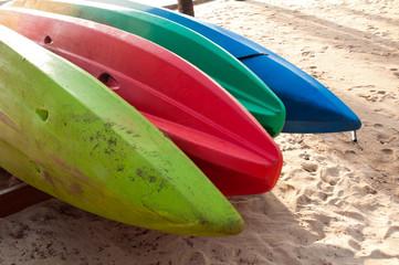 canoes in a row on the beach