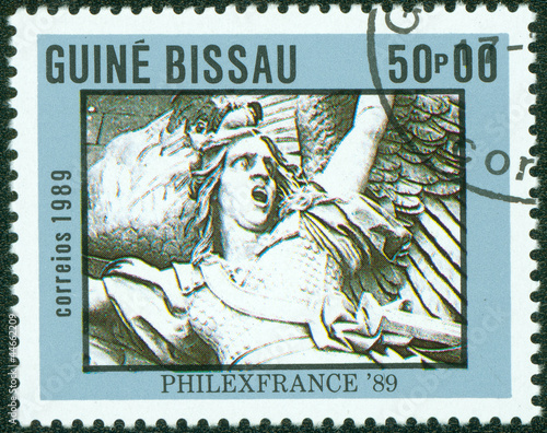 stamp printed by Guinea, shows a statue of French Revolution
