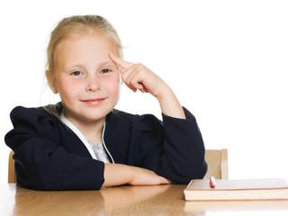 schoolgirl is sitting at his desk