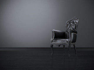 Vintage black chair in the dark room