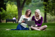 Young Women in Park with Tech