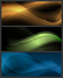 Set of abstract wave patterns on dark background