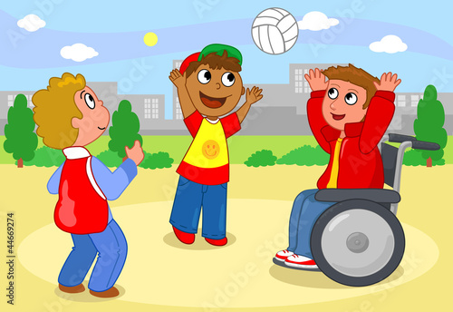 Two children playing volleyball with a boy on wheelchair.