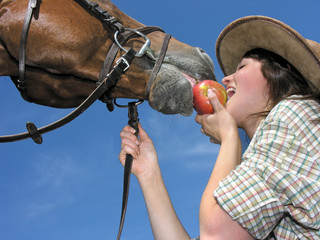 young cowgirl and her friend eating an apple