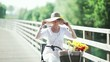 Woman with straw hat and bike; Full HD Photo JPEG