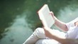 Woman relaxing while reading a book; Full HD Photo JPEG
