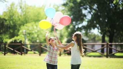 Two little girls playing with balloons; Ful HD Photo JPEG