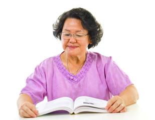 Asian senior woman serious reading