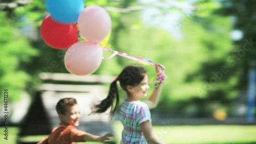 Children playing outdoors with balloons; Full HD Photo JPEG