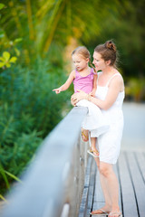 Mother and daughter outdoors