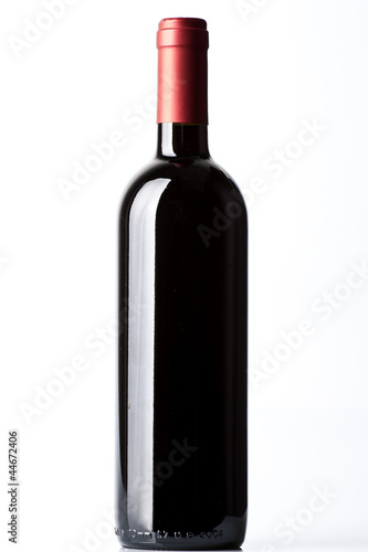 A red wine bottle on the white background