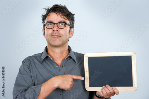 man is pointing at a tablet