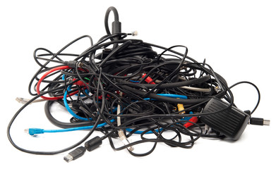 Heap of computer cables isolated on white