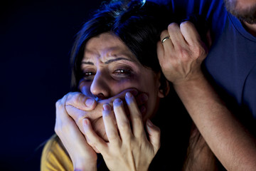 Woman with hand in front of her face not able to scream