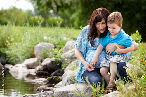 Mother and Son Playing Near Lake