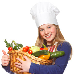 junior cook with vegetables smiling and thumbs up