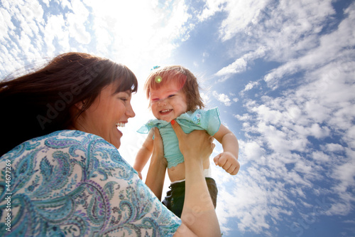 Mother Holding Daughter in Air
