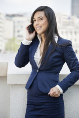 Young Indian businesswoman using cell phone
