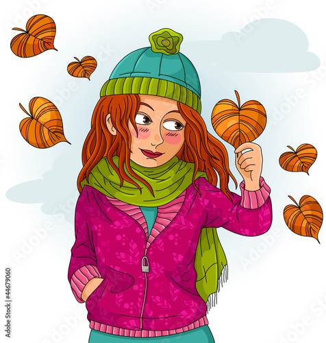 girl holding a heart shaped autumn leaf